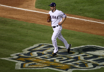ARLINGTON, TX - NOVEMBER 01:  Cliff Lee #33 of the Texas Rangers runs across the World Series logo on his way to the dugout at the end of an inning against the San Francisco Giants in Game Five of the 2010 MLB World Series at Rangers Ballpark in Arlington