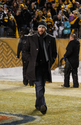 PITTSBURGH - JANUARY 28:  Ben Roethlisberger #7 of the Pittsburgh Steelers walks to the stage during the Super Bowl XLV Pep Rally on January 28, 2011 at Heinz Field in Pittsburgh, Pennsylvania.  (Photo by Jared Wickerham/Getty Images)