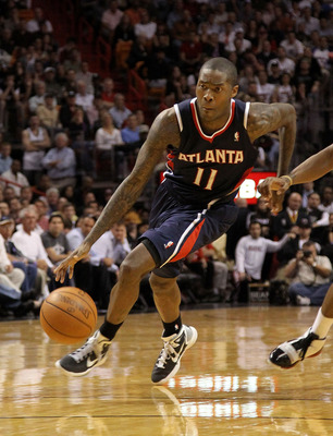 MIAMI, FL - JANUARY 18:  Jamal Crawford #11 of the Atlanta Hawks drives to the lane during a game against the Miami Heat at American Airlines Arena on January 18, 2011 in Miami, Florida. NOTE TO USER: User expressly acknowledges and agrees that, by downlo