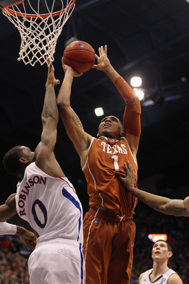 LAWRENCE, KS - JANUARY 22:  Gary Johnson #1 of the Texas Longhorns shoots over Thomas Robinson #0 of the Kansas Jayhawks during the game on January 22, 2011 at Allen Fieldhouse in Lawrence, Kansas.  (Photo by Jamie Squire/Getty Images)