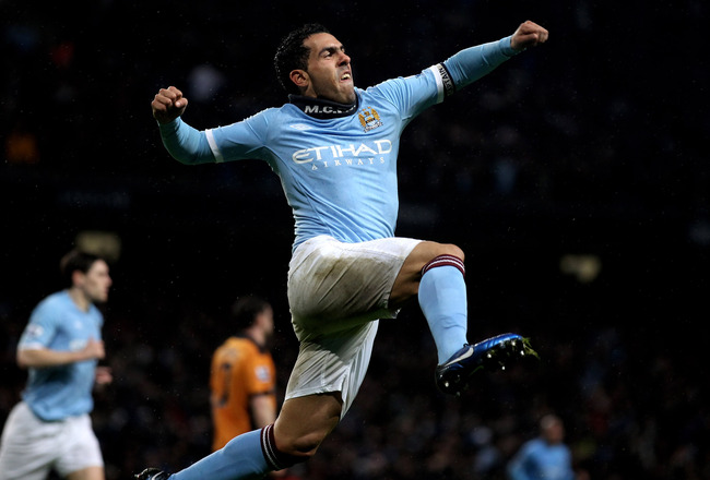 MANCHESTER, ENGLAND - JANUARY 15:  Carlos Tevez of Manchester City celebrates scoring his team's second goal during the Barclays Premier League match between Manchester City and Wolverhampton Wanderers at the City of Manchester Stadium on January 15, 2011