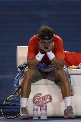 MELBOURNE, AUSTRALIA - JANUARY 26:  Rafael Nadal of Spain shows his emotions betweein games in his quarterfinal match against David Ferrer of Spain during day ten of the 2011 Australian Open at Melbourne Park on January 26, 2011 in Melbourne, Australia.