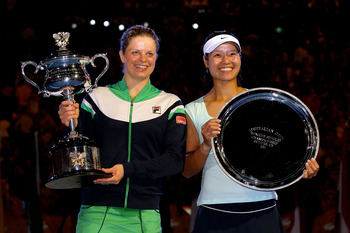 MELBOURNE, AUSTRALIA - JANUARY 29:  Kim Clijsters of Belgium poses with the Daphne Akhurst Trophy after winning her women's final match with Na Li of China during day thirteen of the 2011 Australian Open at Melbourne Park on January 29, 2011 in Melbourne,
