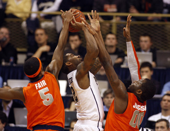 PITTSBURGH, PA - JANUARY 17:  Brad Wanamaker #22 of the Pittsburgh Panthers battles to the basket against C.J. Fair #5 and Rick Jackson #0 of the Syracuse Orange at Petersen Events Center on January 17, 2011 in Pittsburgh, Pennsylvania.  The Panthers defe