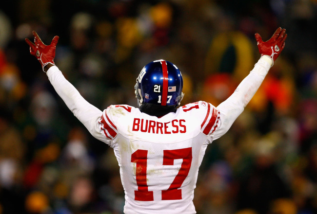 GREEN BAY, WI - JANUARY 20:  Wide receiver Plaxico Burress #17 of the New York Giants reacts to the crowd during the NFC championship game against the Green Bay Packers on January 20, 2008 at Lambeau Field in Green Bay, Wisconsin.  (Photo by Jamie Squire/