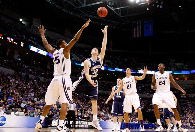 OKLAHOMA CITY - MARCH 20:  Jimmer Fredette #32 of the Brigham Young Cougars drives for a shot attempt against Luis Colon #15 of the Kansas State Wildcats during the second round of the 2010 NCAA men's basketball tournament at Ford Center on March 20, 2010