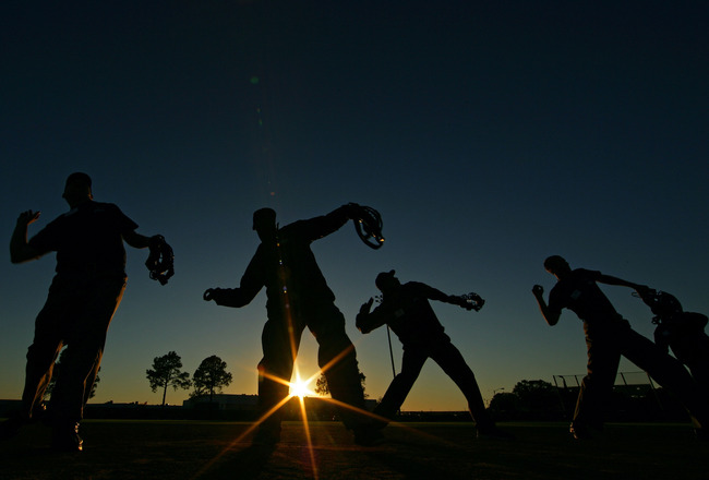 KISSIMMEE, FL - JANUARY 28:  Student Umpires perform a signal drill during the Jim Evans Academy of Professional Umpiring on January 28, 2011 at the Houston Astros Spring Training Complex  in Kissimmee, Florida.  Jim Evans was a Major League Umpire for 28