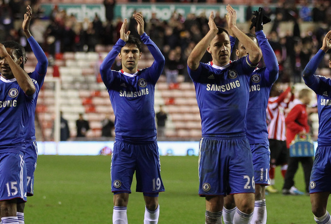 SUNDERLAND, ENGLAND - FEBRUARY 01:  John Terry of Chelsea (second right) with his team mates celebrate victory after the Barclays Premier League match between Sunderland and Chelsea at the Stadium of Light on February 1, 2011 in Sunderland, England.  (Pho