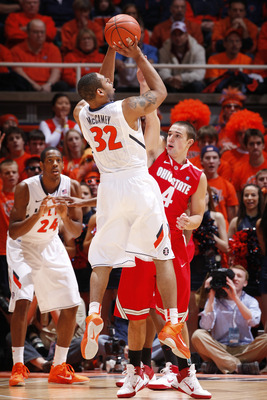 CHAMPAIGN, IL - JANUARY 22: Demetri McCamey #32 of the Illinois Fighting Illini takes a shot while being defended by Aaron Craft #4 of the Ohio State Buckeyes at Assembly Hall on January 22, 2011 in Champaign, Illinois. Ohio State won 73-68. (Photo by Joe