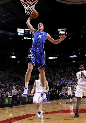 PORTLAND, OR - NOVEMBER 27:  Mason Plumlee #5 of the Duke Blue Devils goes up for a shot against the Oregon Ducks on November 27, 2010 at the Rose Garden in Portland, Oregon.  (Photo by Jonathan Ferrey/Getty Images)