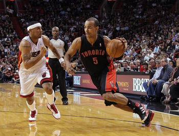 MIAMI, FL - JANUARY 22:  Jerryd Bayless #5 of the Toronto Raptors dribbles past Eddie House #55 of the Miami Heat during a game at American Airlines Arena on January 22, 2011 in Miami, Florida. NOTE TO USER: User expressly acknowledges and agrees that, by