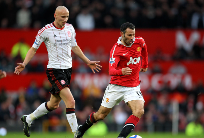 MANCHESTER, ENGLAND - JANUARY 09:  Ryan Giggs of Manchester United goes past Jonjo Shelvey of Liverpool during the FA Cup sponsored by E.ON 3rd round match between Manchester United and Liverpool at Old Trafford on January 9, 2011 in Manchester, England.