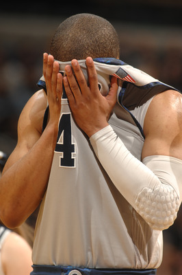 WASHINGTON, DC- JANUARY 12:  Chris Wright #4 of the Georgetown Hoya reacts to a loss after a college basketball game against the Pittsburgh Panthers on January 12, 2011 at the Verizon Center in Washington, DC.   The Panthers won 72-57.  (Photo by Mitchell