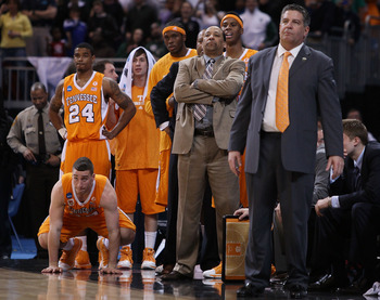 ST. LOUIS - MARCH 28:  Head coach Bruce Pearl of the Tennessee Volunteers and the rest of his bench watch as the Michigan State Spartans shoot a free throw during the midwest regional final of the 2010 NCAA men's basketball tournament at the Edward Jones