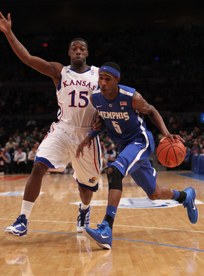 NEW YORK, NY - DECEMBER 07: Will Barton #5 of the Memphis Tigers drives to the basket against Elijah Johnson #15 of the Kansas Jayhawks during their game at the Jimmy V Classic at Madison Square Garden on December 7, 2010 in New York City.  (Photo by Nick