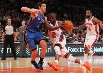 NEW YORK, NY - DECEMBER 22:  Raymond Felton #2 of the New York Knicks drives against Anthony Randolph #4 of the Oklahoma City Thunder at Madison Square Garden on December 22, 2010 in New York City.   NOTE TO USER: User expressly acknowledges and agrees th
