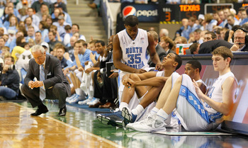 GREENSBORO, NC - DECEMBER 18:  Reggie Bullock #35, John Henson #31, Larry Drew II #11 and Tyler Zeller #44 of the North Carolina Tar Heels wait to enter the game as head coach Roy Williams reacts to a basket by the Texas Longhorns at Greensboro Coliseum o