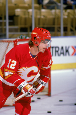 INGLEWOOD, CA - 1988:  Hakan Loob #12 of the Calgary Flames skates during warm-ups prior to a game against the Los Angeles Kings in the 1988 NHL season at the Great Western Forum in Inglewood, California.  (Photo by Tim DeFrisco/Getty Images)