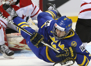 BUFFALO, NY - DECEMBER 31: Forward Rickard Rakell #27 of Sweden is dumped to the ice during the 2011 IIHF World U20 Championship game between Canada and Sweden on December 31, 2010 at HSBC Arena in Buffalo, New York. (Photo by Tom Szczerbowski/Getty Image