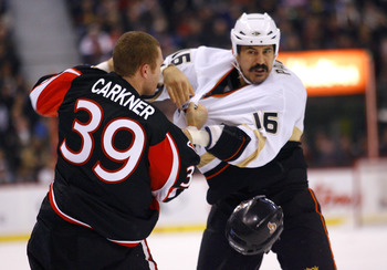 OTTAWA, ON - JANUARY 18:  Matt Carkner #39 of the Ottawa Senators looses his helmet in a fight with George Parros #16 of the Anaheim Ducks in a game at Scotiabank Place on January 18, 2011 in Ottawa, Canada.  (Photo by Phillip MacCallum/Getty Images)