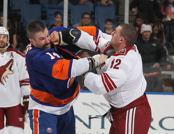 UNIONDALE, NY - DECEMBER 18:  Trevor Gillies #14 of the New York Islanders fights Paul Bissonnette #12 of the Phoenix Coyotes during their game on December 18, 2010 at the Nassau Coliseum in Uniondale, New York.  (Photo by Al Bello/Getty Images)