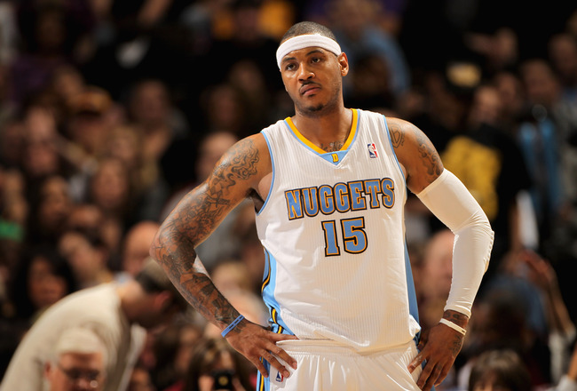 DENVER, CO - JANUARY 21:  Carmelo Anthony #15 of the Denver Nuggets looks on during a break in the action against the Los Angeles Lakers at the Pepsi Center on January 21, 2011 in Denver, Colorado. The Lakers defeated the Nuggets 107-97. NOTE TO USER: Use