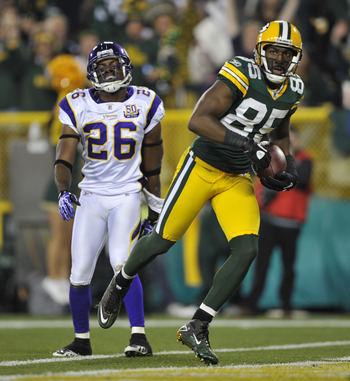 GREEN BAY, WI - OCTOBER 24:  Antoine Winfield #26 of the Minnesota Vikings reacts as Greg Jennings #85 of the Green Bay Packers scores a touchdown during their game at Lambeau Field on October 24, 2010 in Green Bay, Wisconsin. (Photo by Jim Prisching/Gett