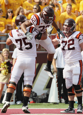 CHESTNUT HILL, MA - SEPTEMBER 25:  Darren Evans #32 of Virginia Tech Hokies is congratulated by teammates Greg Nosal #75 and Andrew Lanier #72 after Evans scored a touchdown in the first half against the Boston Collge Eagles on September 25, 2010 at Alumn