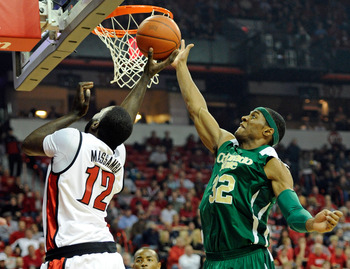 LAS VEGAS, NV - JANUARY 19:  Andy Ogide #32 of the Colorado State Rams blocks a shot by Brice Massamba #12 of the UNLV Rebels during their game at the Thomas & Mack Center January 19, 2011 in Las Vegas, Nevada. Colorado State won 78-63.  (Photo by Ethan M