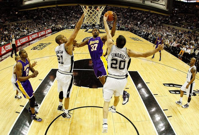 SAN ANTONIO - JANUARY 12:  Forward Ron Artest #37 of the Los Angeles Lakers takes a shot against Tim Duncan #21 and Manu Ginobili #20 of the San Antonio Spurs on January 12, 2010 at AT&T Center in San Antonio, Texas.  NOTE TO USER: User expressly acknowle