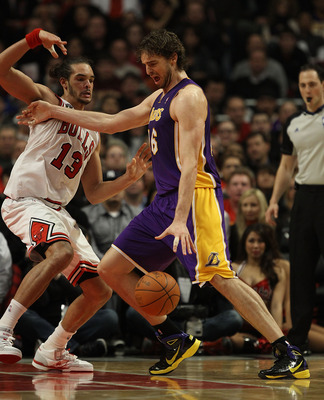 CHICAGO, IL - DECEMBER 10: Pau Gasol #16 of the Los Angeles Lakers moves against Joakim Noah #13 of the Chicago Bulls at the United Center on December 10, 2010 in Chicago, Illinois. The Bulls defeated the Lakers 88-84. NOTE TO USER: User expressly acknowl