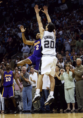 SAN ANTONIO - MAY 13:  Derek Fisher #2 of the Los Angeles Lakers shoots and makes the game-winning shot at the buzzer over Emanuel Ginobili #20 of the San Antonio Spurs during game five of the Western Conference Semifinals during the 2004 NBA Playoffs on