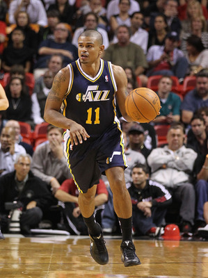 MIAMI - NOVEMBER 09:  Earl Watson #11 of the Utah Jazz brings the ball up the court during a game agsinst the Miami Heat at American Airlines Arena on November 9, 2010 in Miami, Florida. NOTE TO USER: User expressly acknowledges and agrees that, by downlo