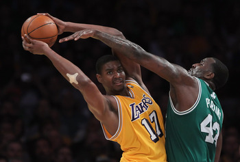 LOS ANGELES, CA - JANUARY 30:  Andrew Bynum #17 of the Los Angeles Lakers is defended by Kendrick Perkins #43 of the Boston Celtics in the second half at Staples Center on January 30, 2011 in Los Angeles, California. The Celtics defeated the Lakers 109-96