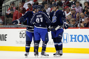 RALEIGH, NC - JANUARY 30: Team Lidstrom players including Phil Kessel #81 of the Toronto Maple Leafs and Anze Kopitar #11 of the Los Angeles Kings reacts against Team Staal in the 58th NHL All-Star Game at RBC Center on January 30, 2011 in Raleigh, North