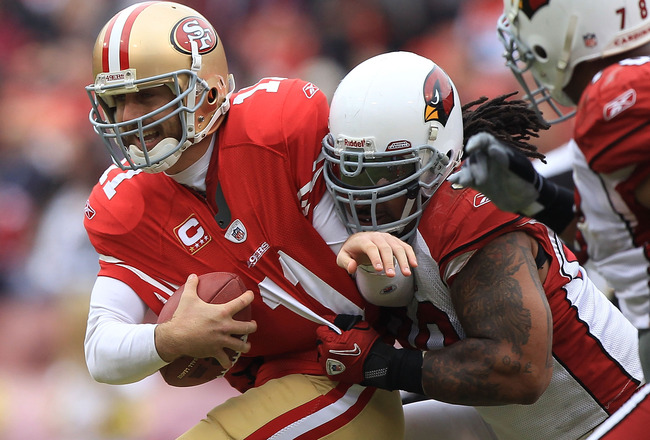 SAN FRANCISCO, CA - JANUARY 02:    Alex Smith #11 of the San Francisco 49ers is sacked by Darnell Dockett #90 of the Arizona Cardinals during an NFL game at Candlestick Park on January 2, 2011 in San Francisco, California.  (Photo by Jed Jacobsohn/Getty I