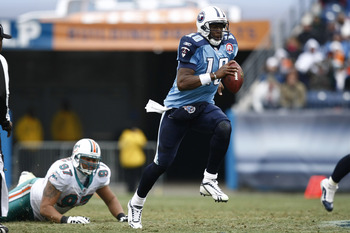 NASHVILLE, TN - DECEMBER 20: Vince Young #10 of the Tennessee Titans runs with the football against the Miami Dolphins at LP Field on December 20, 2009 in Nashville, Tennessee. The Titans defeated the Dolphins 27-24 in overtime. (Photo by Joe Robbins/Gett