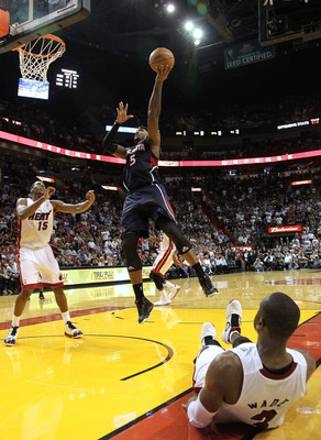 MIAMI, FL - JANUARY 18:  Josh Smith #5 of the Atlanta Hawks shoots over Dwyane Wade #3 of the Miami Heat  during a game at American Airlines Arena on January 18, 2011 in Miami, Florida. NOTE TO USER: User expressly acknowledges and agrees that, by downloa
