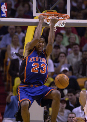4 Feb 2001:  Marcus Camby #23 of the New York Knicks dunks the ball in the first half of their game at the American Airlines Arena in Miami, Florida. DIGITAL IMAGE. NOTE TO USER: It is expressly understood that the only rights Allsport are offering to lic