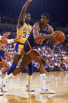 NEW YORK - 1987:  Bill Cartwright #25 of the New York Knicks posts up Magic Johnson #32 of the Los Angeles Lakers during an NBA game at Madison Square Garden in New York City, New York in 1987.  (Photo by: Stephen Dunn/Getty Images)