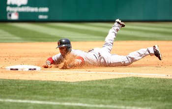 ANAHEIM, CA - MAY 14:  Dustin Pedroia #15 of the Boston Red Sox slides into third base against the Los Angeles Angels of Anaheim on May 14, 2009 at Angel Stadium in Anaheim, California.   The Angels won 5-4 in 12 innings.  (Photo by Stephen Dunn/Getty Ima