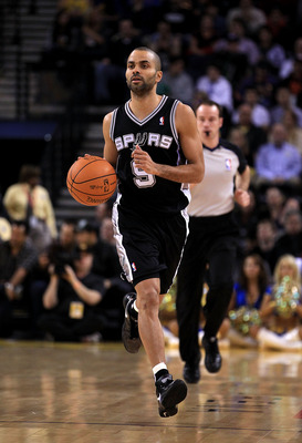 OAKLAND, CA - JANUARY 24:  Tony Parker #9 of the San Antonio Spurs in action against the Golden State Warriors at Oracle Arena on January 24, 2011 in Oakland, California.  NOTE TO USER: User expressly acknowledges and agrees that, by downloading and or us