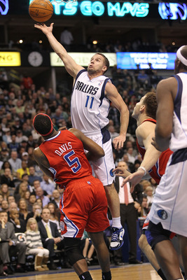DALLAS, TX - JANUARY 25:  Guard Jose Juan Barea #11 of the Dallas Mavericks takes a shot against Baron Davis #5 of the Los Angeles Clippers at American Airlines Center on January 25, 2011 in Dallas, Texas.  NOTE TO USER: User expressly acknowledges and ag