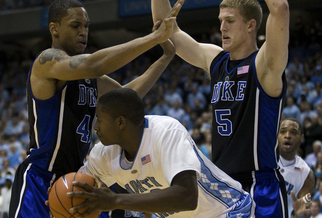 CHAPEL HILL, NC - FEBRUARY 10: North Carolina forward Ed Davis #32 looks to pass around Duke forward Lance Thomas (42) and Duke forward Mason Plumlee (5) during a men's college basketball game at Dean Smith Center on February 10, 2010 in Chapel Hill, Nort