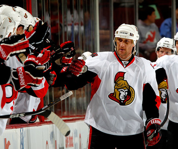 NEWARK, NJ - FEBRUARY 01:  Alex Kovalev #27 of the Ottawa Senators is congratulated by teamates after his goal against the New Jersey Devils during the second period of an NHL hockey game at the Prudential Center on February 1, 2011 in Newark, New Jersey.