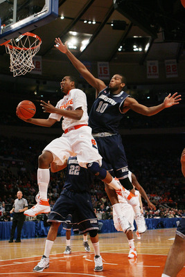NEW YORK - MARCH 11:  Kris Joseph #32 of the Syracuse Orange goes to the hoop against Greg Monroe #10 of the Georgetown Hoyas during the quarterfinal of the 2010 NCAA Big East Tournament at Madison Square Garden on March 11, 2010 in New York City.  (Photo