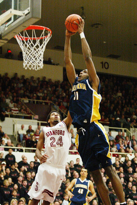 4 Jan 2002:  Jamal Sampson of the University of California shoots over Julis Barnes of Stanford during a Pac-10 game at Maples Pavillion at Stanford University in Palo Alto, California. DIGITAL IMAGE Mandatory Credit: Jed Jacobsohn/Getty Images