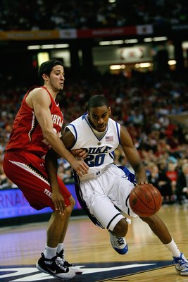 ATLANTA - MARCH 14:  Elliot Williams #20 of the Duke Blue Devils drives against Greivis Vasquez #21 of the Maryland Terrapins during the semifinals of the 2009 ACC Men's Basketball Tournament on March 14, 2009 at the Georgia Dome in Atlanta, Georgia.  (Ph