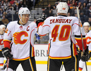 NASHVILLE, TN - FEBRUARY 01:  Jarome Iginla #12 and Alex Tanguay #40 of the Calgary Flames celebrate after a goal against the Nashville Predatorson February 1, 2011 at the Bridgestone Arena in Nashville, Tennessee.  (Photo by Frederick Breedon/Getty Image