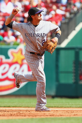 ST. LOUIS - OCTOBER 2: Troy Tulowitzki #2 of the Colorado Rockies throws to first base against the St. Louis Cardinals at Busch Stadium on October 2, 2010 in St. Louis, Missouri.  The Cardinals beat the Rockies 1-0 in 11 innings.  (Photo by Dilip Vishwana